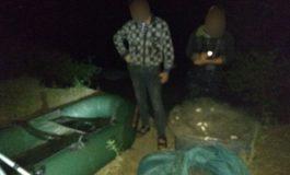 Pescari argeşeni încătuşaţi după ce au fost prinşi la pescuit cu japca